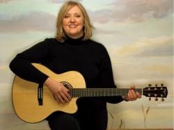 Connie Kaldor with guitar