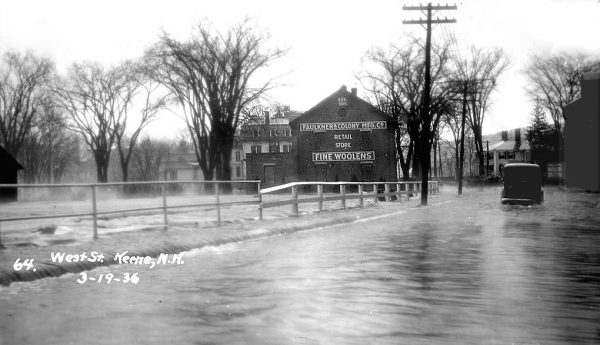 F is for Flood of 1936- flood waters turn West Street near the Faulkner mill into a running river