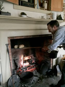 Cousin Thomas pulls bread from the hearth oven