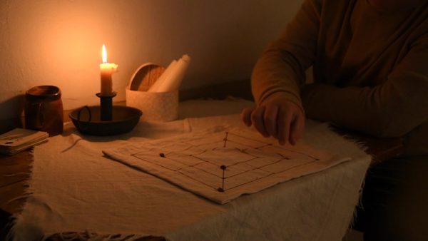 Playing the Mills Game by candlelight