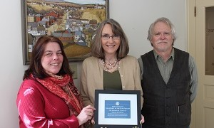 Christina Meinke, from the Peterborough Chamber of Commerce, presents the nomination  to Director Michelle Stahl a few days before the Gala Event. To the right is Monadnock Center Board president Gordon Peery.