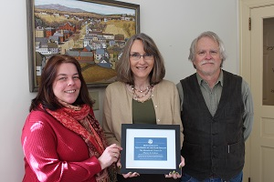 Christina Meinke (center), from the Peterborough Chamber of Commerce, presents the nomination  to Director Michelle Stahl a few days before the Gala Event. To the right is Monadnock Center Board president Gordon Peery.