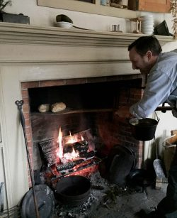 Pulling Phoenix Mill House Bread from the beehive oven