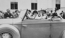 Eleanor Roosevelt behind the wheel of an open roadster